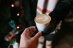 Coffee for you with love. Someone gives another person a cup of hot drink royalty free stock photos