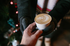 Coffee for you with love. Someone gives another person a cup of hot drink stock images