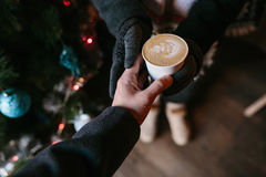 Coffee for you with love. Someone gives another person a cup of hot drink royalty free stock photo