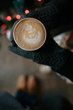 Coffee for you with love. Someone holding a hot drink on New Year's Eve royalty free stock photography