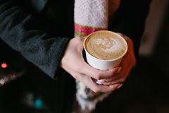 Coffee for you with love. Someone holding a hot drink on New Year's Eve stock images