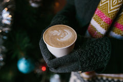 Coffee for you with love. Someone holding a hot drink on New Year's Eve stock photo