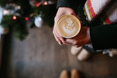 Coffee for you with love. Someone holding a hot drink on New Year's Eve royalty free stock images