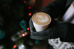 Coffee for you with love. Someone holding a hot drink on New Year's Eve stock image