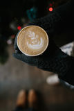 Coffee for you with love. Someone holding a hot drink on New Year's Eve stock photography