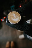 Coffee for you with love. Someone holding a hot drink on New Year's Eve royalty free stock image