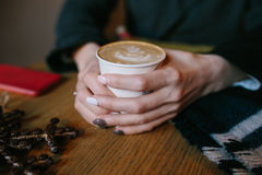 Coffee for you with love. Someone sits at the table and holding a hot drink stock photos