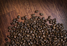 Coffee_beans_on_wood Stock Image
