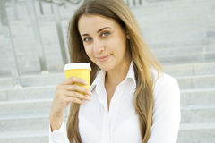 Coffeebreak. Young successful businesswoman having a coffebreak royalty free stock photo