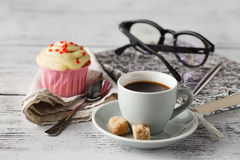 Coffeebreak time in office. Coffee break time in office workplace with muffin and coffee Royalty Free Stock Images