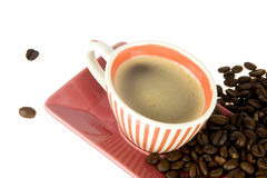 Coffeecup. A colorful coffeecup with coffeebeans on white Royalty Free Stock Photography