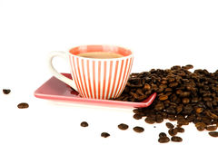 Coffeecup. A colorful striped coffeecup with coffee and coffeebeans Royalty Free Stock Photo