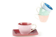 Coffeecup. A striped coffeecup in the front and a pile in the back of the picture Royalty Free Stock Photo