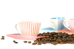 Coffeecup. A colorful coffeecup in the front and two in de back with coffeebeans Stock Photo