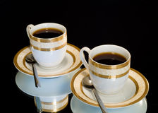 Coffeecup. Set of utensils isolated on a black background royalty free stock image