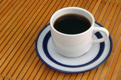 Coffeecup auf Holz Stockbild