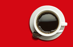 Coffeecup with Coffee on a red background Stock Image