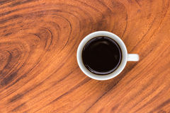 Coffeecup with Coffee in it on a wooden table Stock Photo