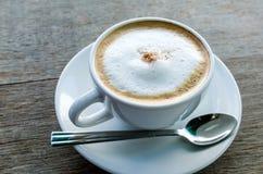 Coffeecup med kaffe Arkivbild