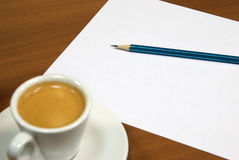 Coffeee and note. Cup of coffee, white sheet and pensil Royalty Free Stock Image