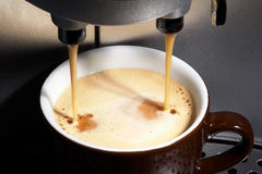 Coffeemachine working. Coffe dispenser with cup of coffee Stock Images