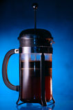 Coffeemaker. With fresh ground coffee on blue background, lit with warm light Stock Photo