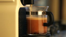 Coffeemaker brewing espresso coffee and man takes cap stock video footage