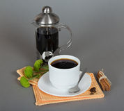 Coffeemaker and cup of coffee Royalty Free Stock Image