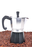 Coffeepot on coffee beans Stock Photos