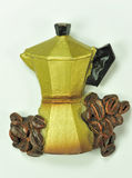 Coffeepot with coffee grains Royalty Free Stock Photos