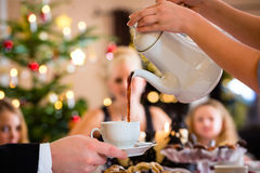 Coffeepot and cookies on Christmas coffee table Stock Image