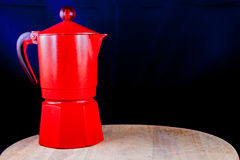 Coffeepot on cutting board Stock Photography