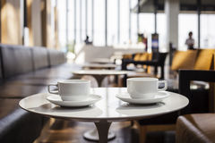 Coffees at coffee shop cafe interior. Two cup of coffee at coffee shop interior cafe lifestyle concept Royalty Free Stock Image
