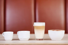 Coffees Displayed On Table. Variety of coffees displayed on table at cafe Royalty Free Stock Images