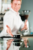 Coffeeshop - barista presents coffee Royalty Free Stock Photo