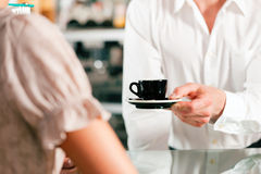 Coffeeshop - barista waits a coffee Royalty Free Stock Image