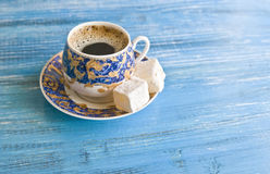 Coffeetime: porcelain cup with coffee and turkish delight Royalty Free Stock Photography