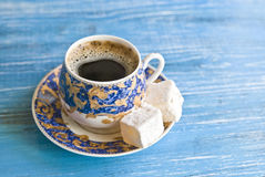 Coffeetime: porcelain cup with coffee and turkish delight stock image
