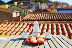 Coffee and Italian sweets with view to Bosa village, Sardinia, Italy Stock Photography