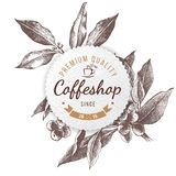 Coffeshop paper emblem. Coffeshop round paper emblem over hand sketched coffee plant branch Royalty Free Stock Image