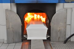 Coffin. A coffin will be driven into the oven Stock Image