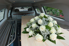 Coffin in car Stock Images