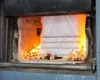 Coffin in cremation. Burning with flame Stock Image