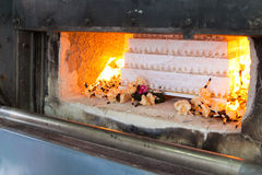 Coffin in cremation. Burning with flame Stock Photo