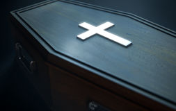 Coffin And Crucifix. A wooden coffin with a metal crucifix and handles dimly lit by a dim spotlight - 3D Render Royalty Free Stock Images