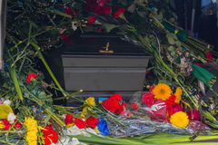 Coffin flowers and Ukrainian symbols Royalty Free Stock Photography