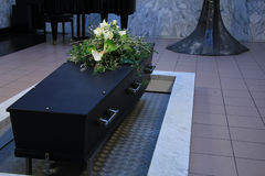 Coffin with funeral flowers. Funeral flowers on a casket, funeral service royalty free stock image