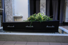 Coffin with funeral flowers Royalty Free Stock Image