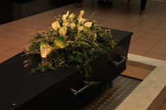 Coffin with funeral flowers Royalty Free Stock Photo