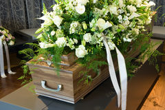 Coffin in morgue. A coffin in a morgue with a flower arrangement Royalty Free Stock Image